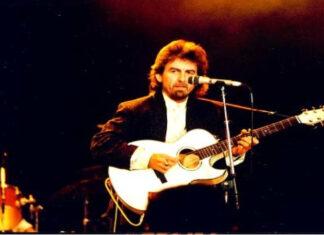 George Harrison playing guitar.
